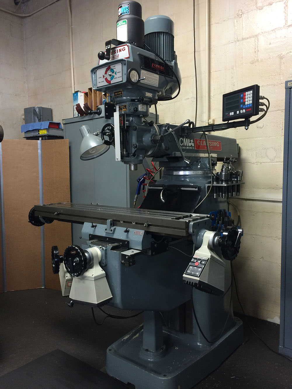 Clausing Kondia Vertical Milling Machine Equipped with Newall Digitial Readout, Kurt Power draw bar, and Servo Power Axis Motors